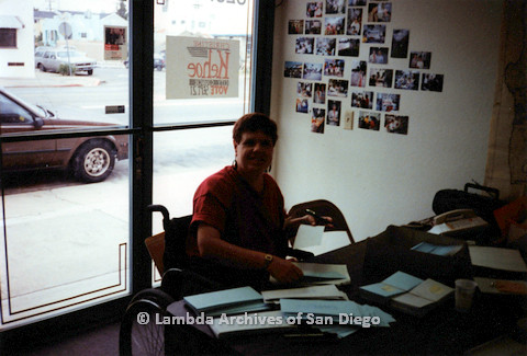 P151.045m.r.t Woman in a wheelchair at desk in campaign office