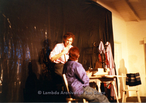 P024.149m.r.t Two people rehearsing on stage