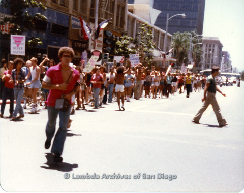 P109.029m.r.t San Diego Pride Parade 1978 View from side of parade, person in pink shirt prominent in front.