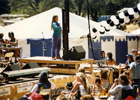 P024.283m.r.t Bonnie Sherwood standing on elevated platform as ASL translator