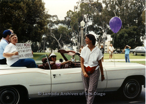 P024.402m.r.t 1990 San Diego Pride Parade:Erika Schatz standing in forefront, Friends of Yachad in car