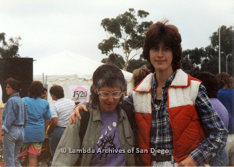 P024.441m.r.t 1990 San Diego Pride: From left to right Jo Freedman and Marghi Kilmer. Marghi Kilmer has her arm around Jo Freedman.