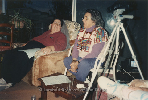 P024.374m.r.t  Edna Myers (left) and Muriel Fisher (right) seated on chairs.