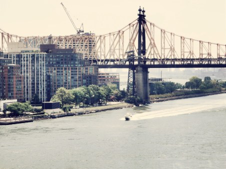 Queensboro Bridge and boat on the East River