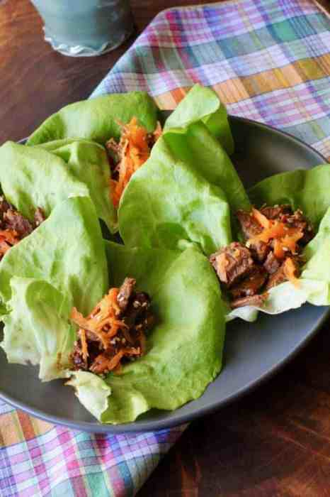 4 Korean Beef lettuce wraps on a plate