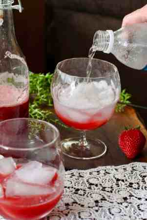 Strawberry Rhubarb syrup in glass with ice