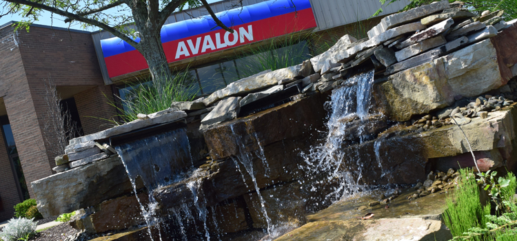 thinking of buying a rv, picture of avalon rv center and the waterfall out front