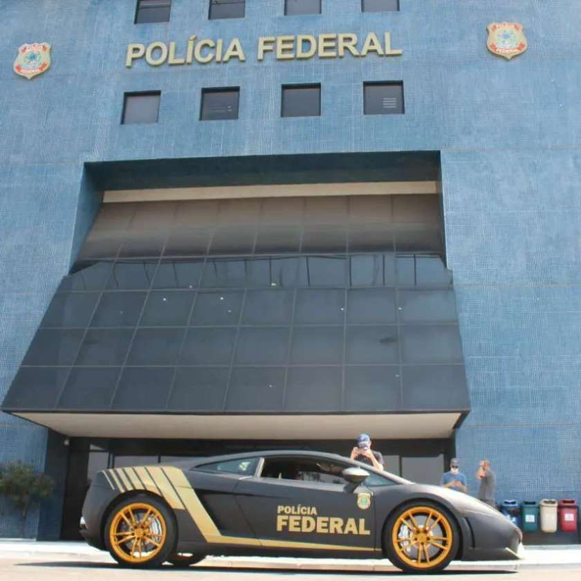 Photo of a PF agent next to a new luxury vehicle
