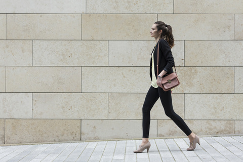 Side-view-of-a-Caucasian-Businesswoman-walking
