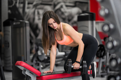 woman-at-gym-with-dumbbells_1303-5538