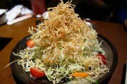 Salad of cabbage, carrot & cherry tomatoes with fried potato