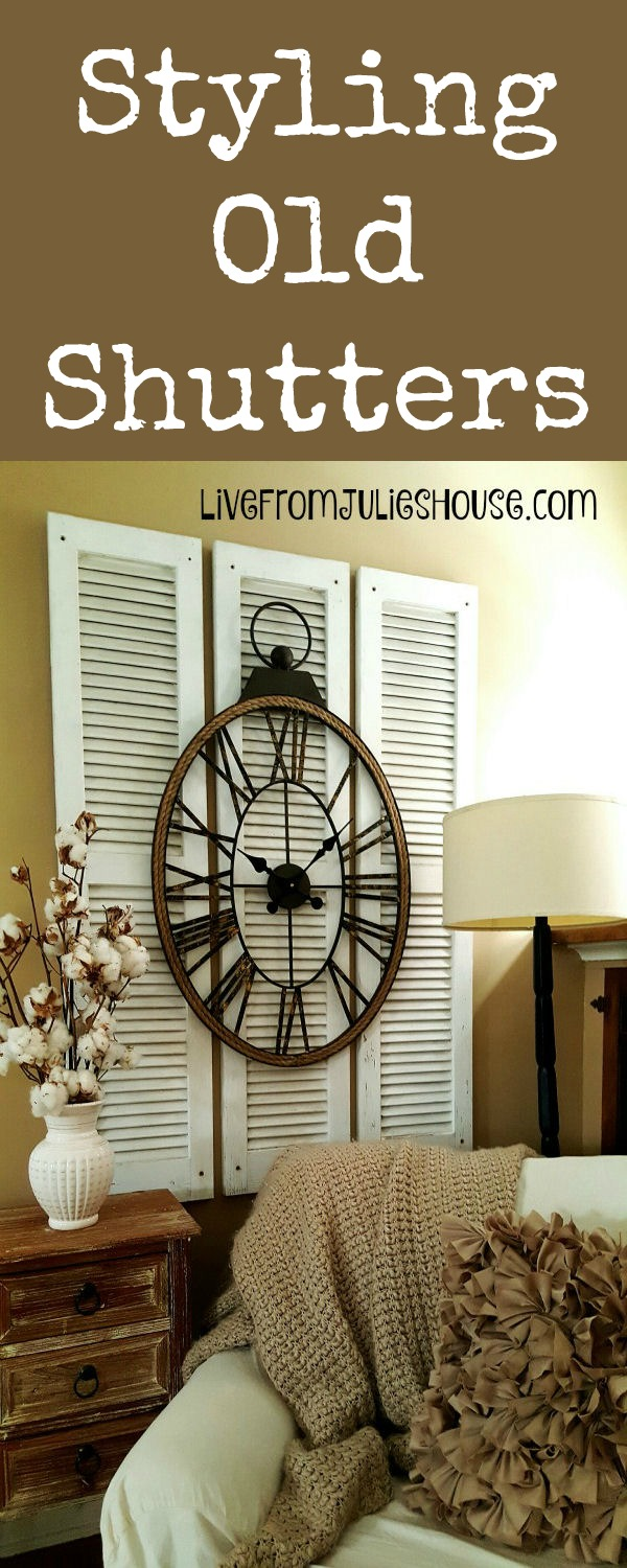 Artwork with Old Shutters - Make a focal point by layering old shutters from the ReStore with a large clock