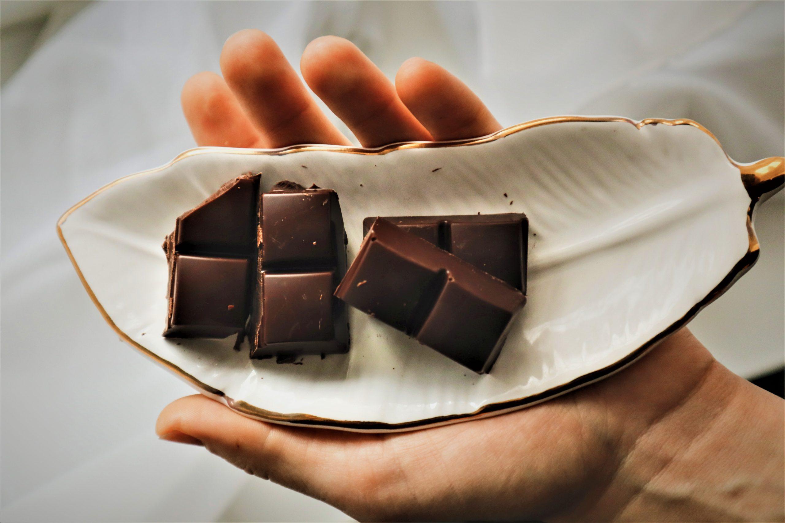 Dark Chocolate in hand, chocolate