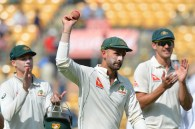 Australian bowler Nathan Lyon (C) shows the ball as his teammates applaud after his eight wicket haul during the first day of the second cricket Test match between India and Australia at The M. Chinnaswamy Stadium in Bangalore on March 4, 2017. ----IMAGE RESTRICTED TO EDITORIAL USE - STRICTLY NO COMMERCIAL USE----- / GETTYOUT / AFP PHOTO / Manjunath KIRAN / ----IMAGE RESTRICTED TO EDITORIAL USE - STRICTLY NO COMMERCIAL USE----- / GETTYOUT
