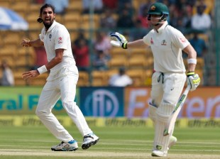 India's Ishant Sharma, left, appeals unsuccessfully for the wicket of Australia's captain Steven Smith, right, during the second day of their second test cricket match in Bangalore, India, Sunday, March 5, 2017. (AP Photo/Aijaz Rahi)