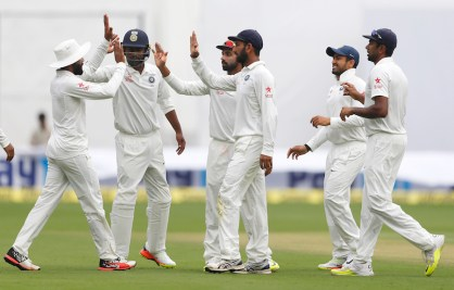 Indian players celebrate the dismissal of Australia's Mitchell Starc during the third day of their second test cricket match in Bangalore, India, Monday, March 6, 2017. (AP Photo/Aijaz Rahi)