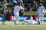 DUNEDIN, NEW ZEALAND - MARCH 09: Kane Williamson of New Zealand slides over the crease to avoid a run out by Vernon Philander of South Africa during day two of the First Test match between New Zealand and South Africa at University Oval on March 9, 2017 in Dunedin, New Zealand. (Photo by Dianne Manson/Getty Images)