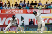 Australia's Peter Handscomb, right, is dismissed by India's Kuldeep Yadav during the first day of their fourth test cricket match in Dharmsala, India, Saturday, March 25, 2017. (AP Photo/Tsering Topgyal)