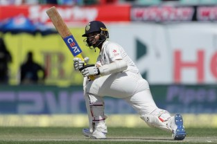 India's Ajinkya Rahane plays a shot during the second day of their fourth test cricket match against India in Dharmsala, India, Sunday, March 26, 2017. (AP Photo/Tsering Topgyal)