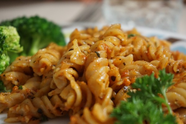 pasta with side of broccoli and parsley
