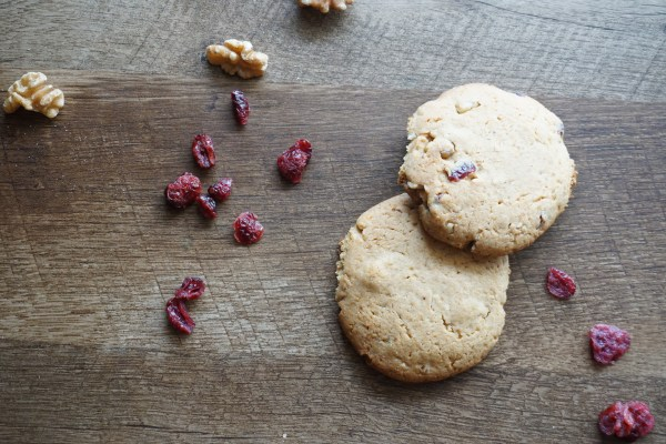 two cookies with cranberries and walnuts by the side