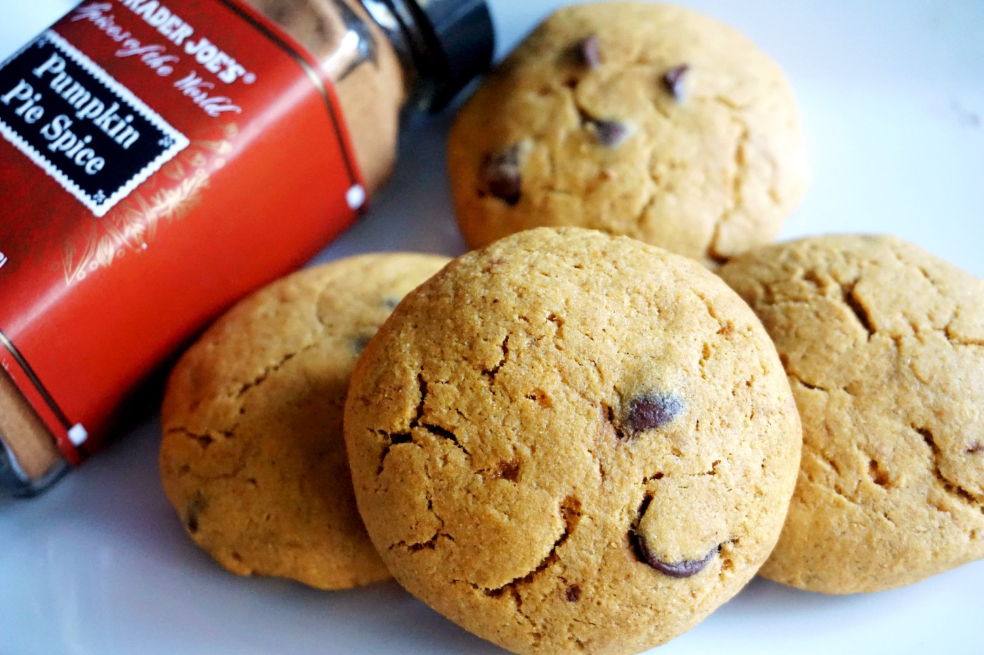 pumpkin cookies with spice bottle by side