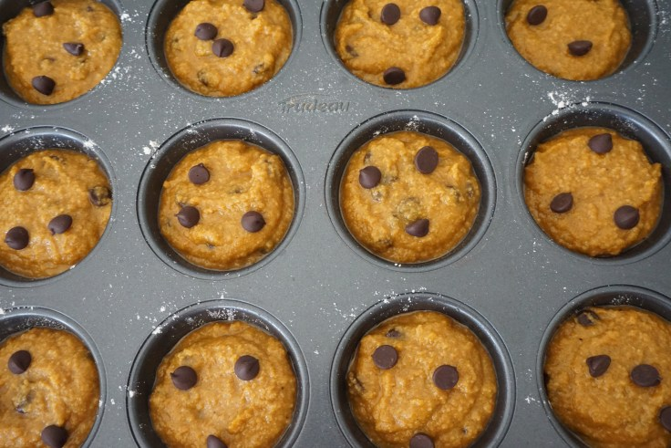 batter scooped in muffin cups