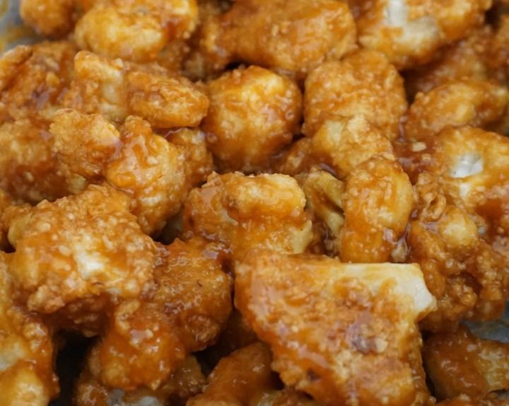 sauce mixed with cauliflower bites