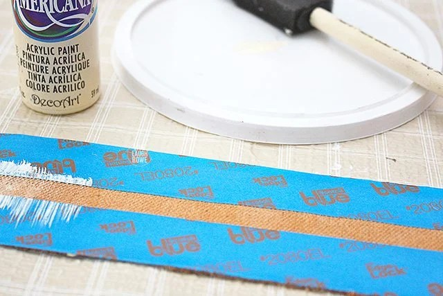 Painting stripes onto the paint dipped drop cloth soap wraps!