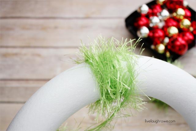 keep wrapping yarn around styrofoam form wreath