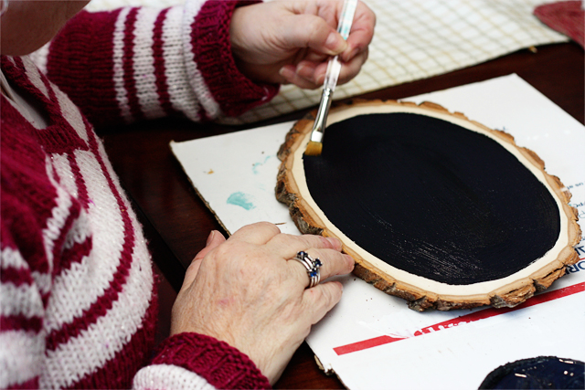 Applying Chalkboard Paint to Wood Slice at livelaughrowe.com