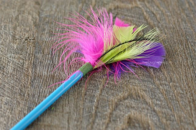 once the feathers are attached, tie ribbon around and tie a bow