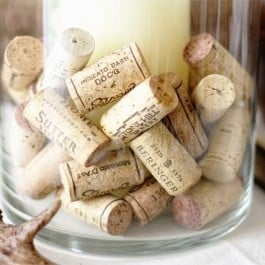 A simple and cost effective vase filler! Use your growing collection of corks as vase fillers... www.livelaughrowe.com #DIY