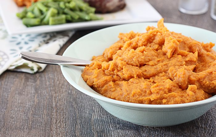 Delicious and flavorful Mashed Sweet Potatoes. The perfect side dish for Thanksgiving or any dinner! Recipe at livelaughrowe.com
