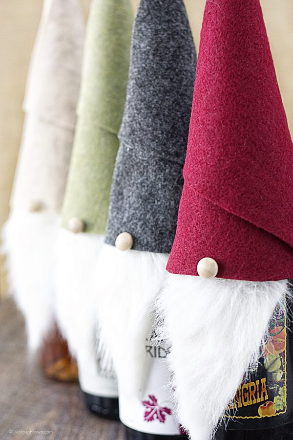 Super fun Gnome Wine Toppers made with felt and faux fur! Love it. www.livelaughrowe.com #gnome #winetopper