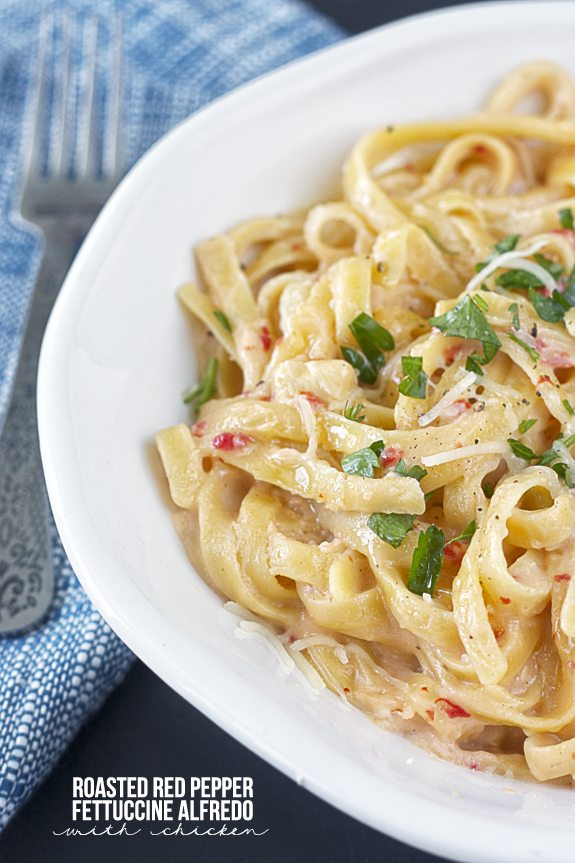 Delicious Roasted Red Pepper Fettuccine Alfredo with Chicken using greek yogurt and other pantry staples! Recipe at www.livelaughrowe.com