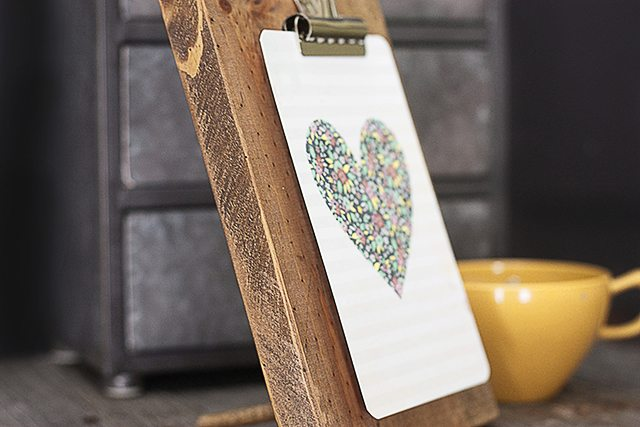 DIY Wooden Clipboard Frame to display pictures, artwork, or calendars. A peg in the back creates a frame stand! www.livelaughrowe.com