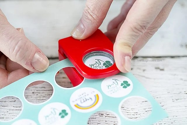 Punching out labels for green party favors made with vending machine capsules! Too cute not to pull together for St. Patrick's Day. livelaughrowe.com