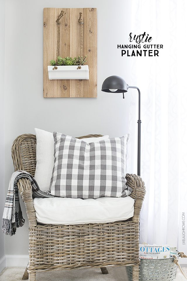Build this Rustic Hanging Gutter Planter in less than 20 minutes! Easy and great for indoor use. livelaughrowe.com