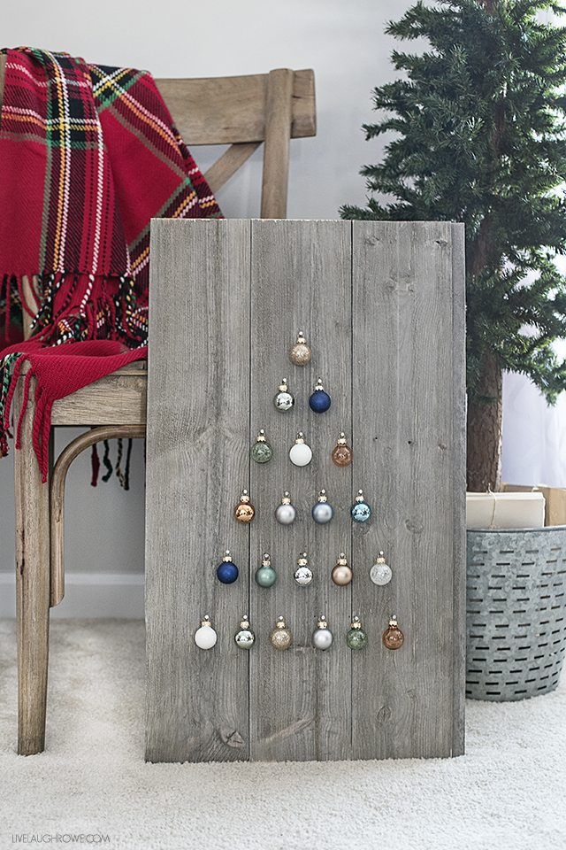 Step by step instructions on how to build a simple, rustic Shiplap Ornament Display. A great addition to your rustic, farmhouse holiday decor -- and you can change out the ornaments! livelaughrowe.com