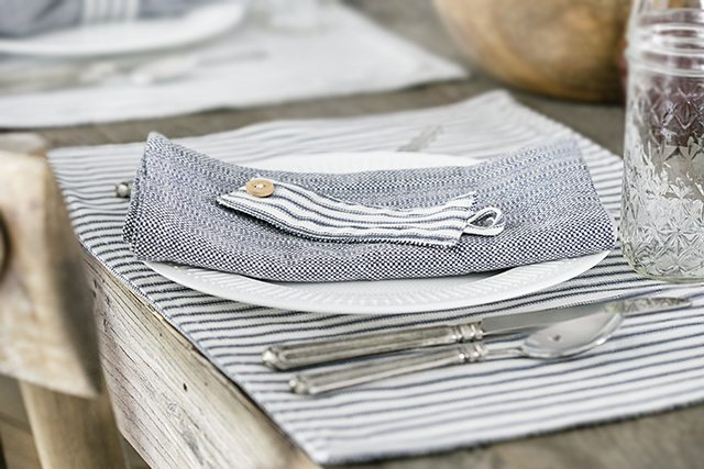 Beautiful farmhouse inspired tablescape using linens with blue ticking stripes. Simple, yet elegant in it's own way. livelaughrowe.com