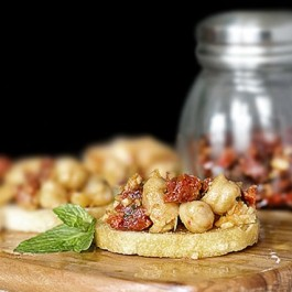 Savory Chickpea Crostini with Sun-Dried Tomatoes and Mint. This recipe makes a delicious snack or appetizer. Recipe at livelaughrowe.com