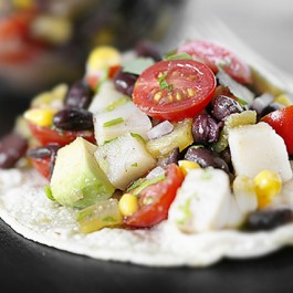 This Mexican specialty features avocado, corn and lime juice tossed together and piled high on crunchy corn tortillas. This tostada recipe is also WW friendly. Find this deliciousness at livelaughrowe.com