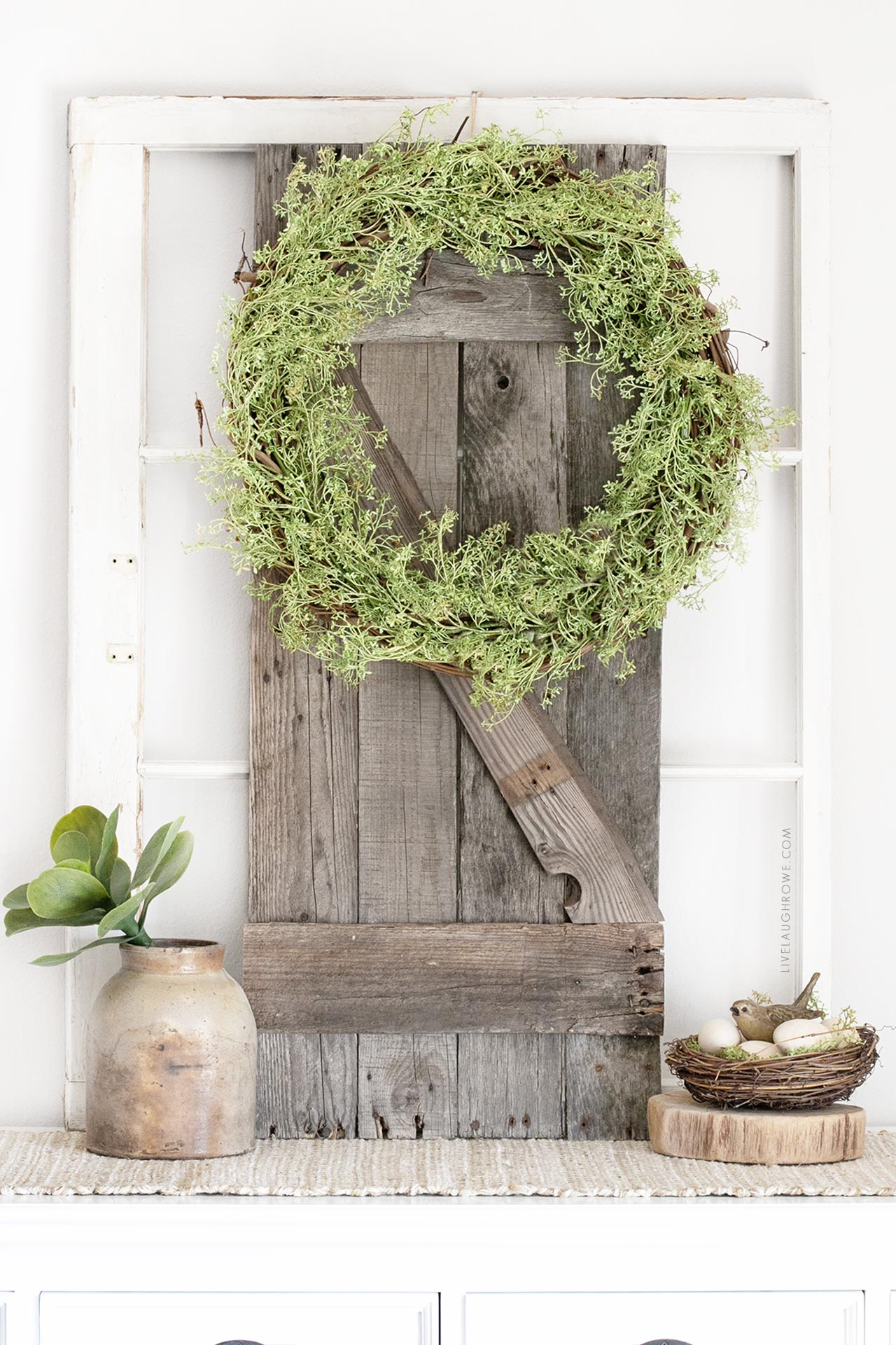 Garland Wreath hanging on Pallet Wood Shutter