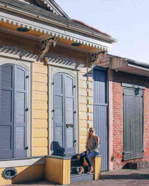 Woman sitting on steps in French Quarter in New Orleans