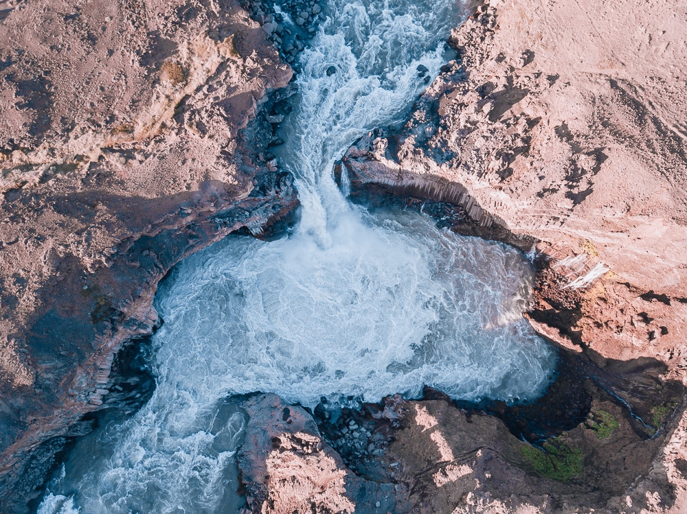 Drone photo from above Aldeyjarfoss waterfall in northern Iceland. Find the top 5 waterfalls in Iceland that you don't want to miss on a Ring Road road trip.