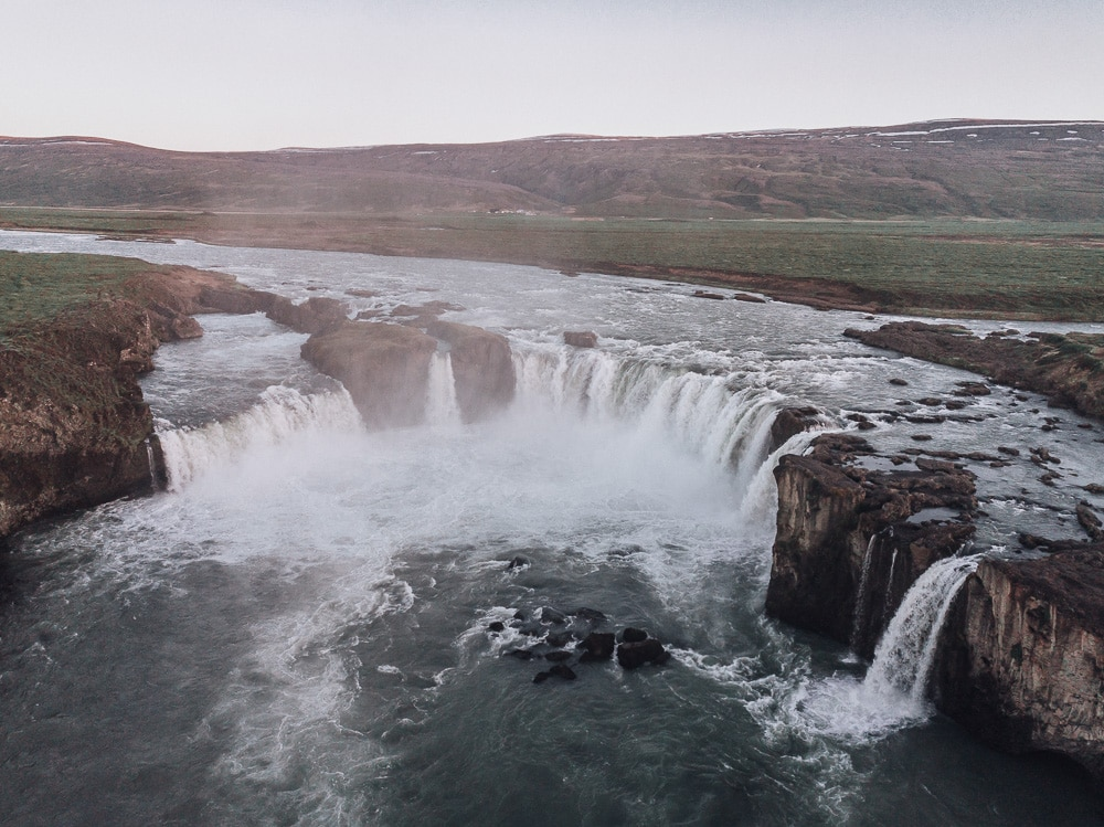 Drone shot of Godafoss Waterfall from above. Find the top 5 waterfalls in Iceland that you don't want to miss on a Ring Road road trip.
