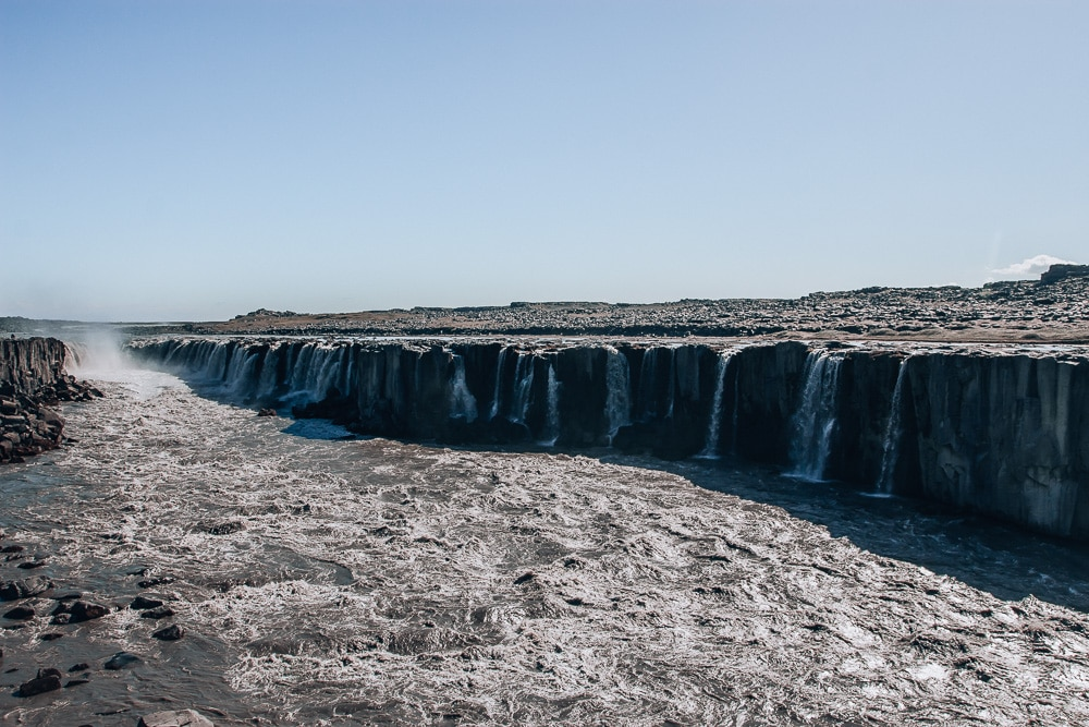 Selfoss Waterfall in northern Iceland from east side of the canyon. Find the top 5 waterfalls in Iceland that you don't want to miss on a Ring Road road trip.