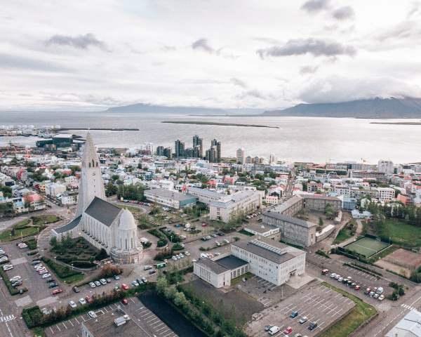 Drone shot of Reykjavik and Hallgrimskirkja from above. Check out our perfect 6 day itinerary for Ring Road in Iceland in summer!