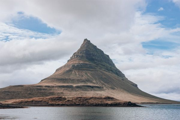 Kirkjufell Mountain in Iceland in summer. Get the perfect Ring Road itinerary for 6 days in Iceland here.